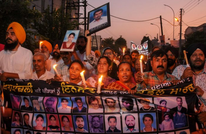 Family members of victims who died in the train tragedy on Dussehra last year take out a candlelight march along with SAD leaders, in Amritsar, Monday, Oct. 7, 2019. (PTI Photo)