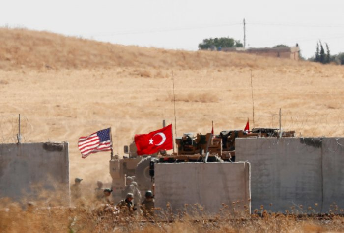 FILE PHOTO: Turkish and U.S. troops return from a joint U.S.-Turkey patrol in northern Syria, as it is pictured from near the Turkish town of Akcakale, Turkey, September 8, 2019. REUTERS