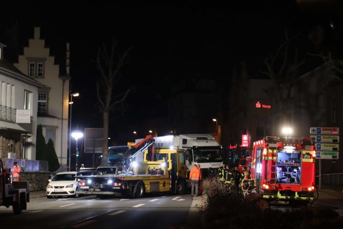 Police cars and an ambulance stand on early October 8, 2019 next to the truck that ploughed into several cars on late October 7 in the centre of the German city of Limburg. AFP