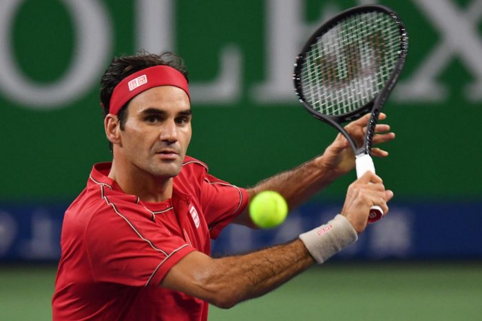 Roger Federer of Switzerland hits a return against Albert Ramos of Spain during their first round men's singles match at the Shanghai Masters tennis tournament in Shanghai on October 8, 2019. (AFP)