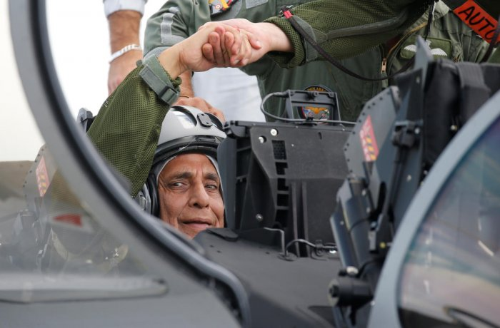 Defence Minister Rajnath Singh sits in the first Indian Air Force Rafale fighter jet on the tarmac before its take-off at the factory of French aircraft manufacturer Dassault Aviation in Merignac near Bordeaux, France. Reuters