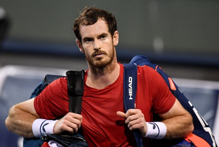 Andy Murray of Britain leaves the court after losing against Fabio Fognini of Italy in their men's singles match at the Shanghai Masters tennis tournament in Shanghai. (AFP Photo)