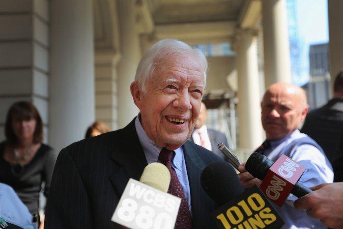 Gormer US President Jimmy Carter speaks to the media at City Hall. (AF Photo)