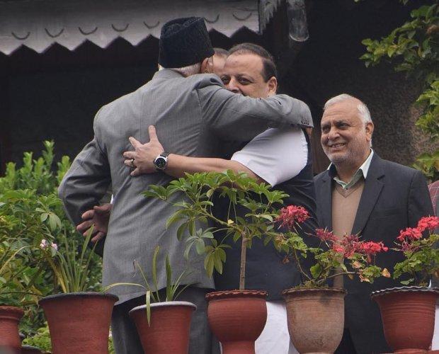 Farooq Abdullah hugging NC provincial president Devender Singh Rana. (Twitter)