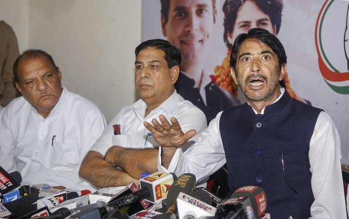 State Congress President G A Mir addresses a press conference, at the party office in Jammu. (PTI Photo)