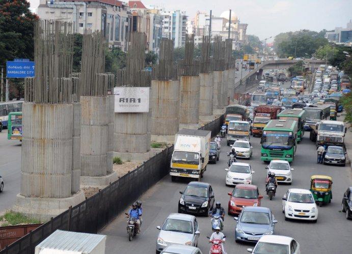 Metro construction under way near KR Puram Hanging Bridge in Bengaluru on Saturday. | DH Photo: Pushkar V