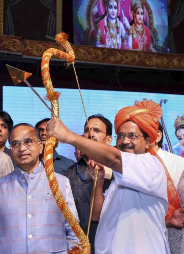 Delhi Chief Minister Arvind Kejriwal prepares holds a bow and arrow at Luv Kush Ramleela on the occasion of Vijaya Dashami ( Dussehra), in New Delhi, Tuesday, Oct. 8, 2019. (PTI Photo)