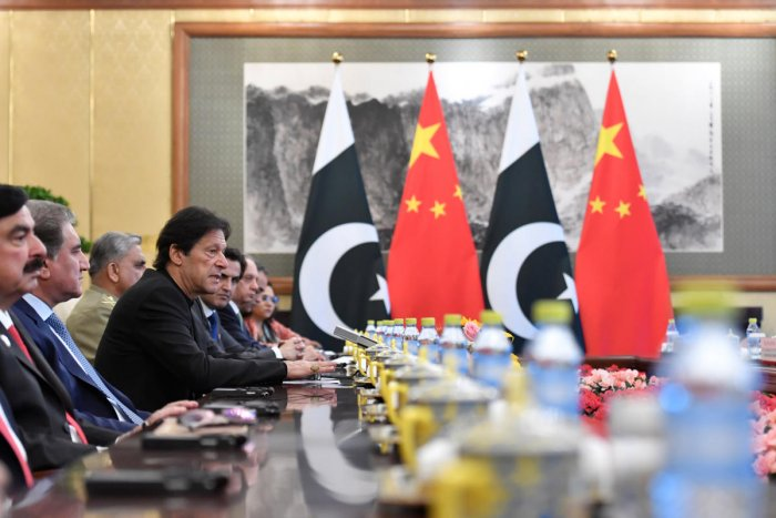 Pakistan's Prime Minister Imran Khan talks to China's President Xi Jinping during their meeting at the Diaoyutai State Guesthouse in Beijing, China, October 9, 2019. (Parker Song/Pool via REUTERS)