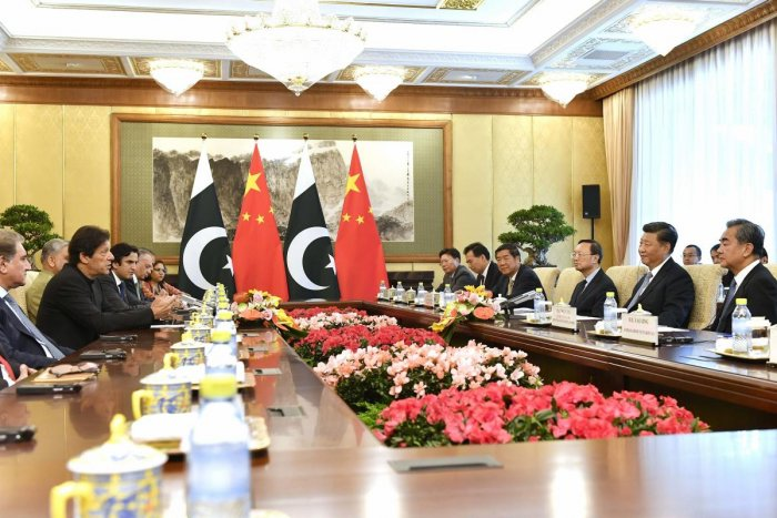Pakistan's Prime Minister Imran Khan, second left, talks to Chinese President Xi Jinping, second right, during their meeting at the Diaoyutai State Guesthouse in Beijing on Wednesday. (AP/PTI)