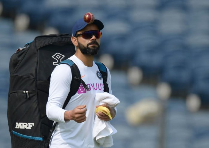 Indian team captain Virat Kohli arrives to attend a cricket training session ahead of the second test match between India and South Africa at the Maharashtra Cricket Association Stadium in Pune on October 9, 2019. (AFP)