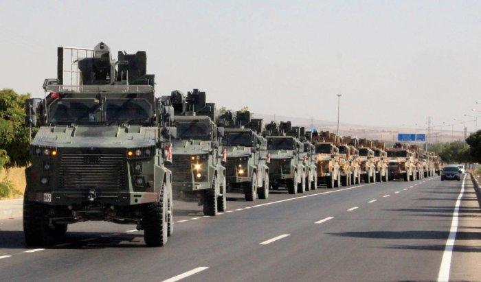 A Turkish miltary convoy is pictured in Kilis near the Turkish-Syrian border, Turkey, October 9, 2019. (Mehmet Ali Dag/ Ihlas News Agency (IHA) via REUTERS)