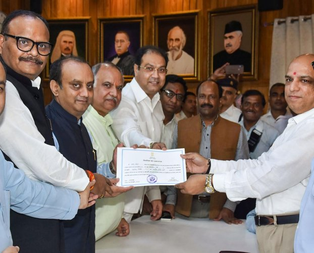 BJP National Spokesperson Sudhanshu Trivedi receives certificate after he was declared elected unopposed to the Rajya Sabha from Uttar Pradesh, in Lucknow on Wednesday. (PTI Photo)