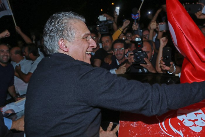 Tunisia's presidential candidate Nabil Karoui greets his supporters after being released from Mornaguia prison near the capital Tunis. (AFP Photo)