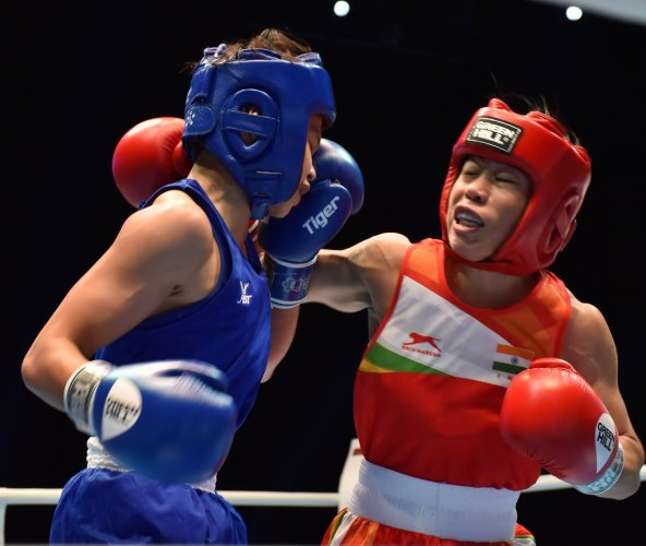 Boxer Mary Kom in action against Thailand's Jutamas Jitpong during Women's World Boxing Championships, in Ulan-ude, Russia. (PTI Photo)