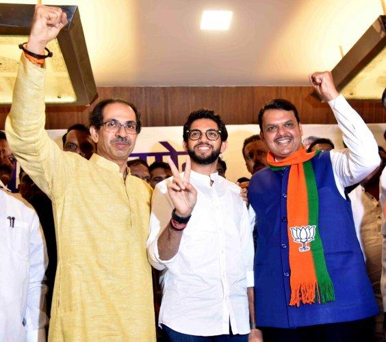 Maharashtra Chief Minister Devendra Fadnavis (R) with Shiv Sena Chief Uddhav Thackeray (L) and Yuva Sena Chief Aaditya Thackeray. (PTI Photo)