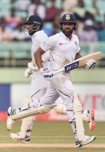 Cheteshwar Pujara (left) and Rohit Sharma will be watched keenly when they link up at the crease in the second Test.