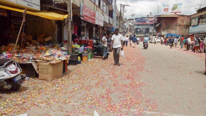 Waste littered on Chowki Road in Madikeri on Wednesday.