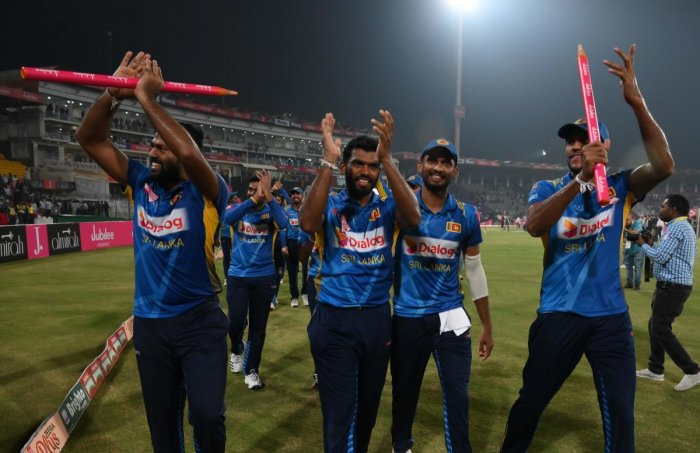 Sri Lanka's cricketers celebrate after beating Pakistan during the third and final Twenty20 International cricket match between Pakistan and Sri Lanka at the Gaddafi Cricket Stadium in Lahore on October 9, 2019. (Photo by AFP)