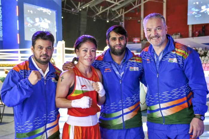 India's Mary Kom (51kg) with her coaches Raffaele Bergamasco (R) and Chhote Lal (R) after winning her bout against Colombia's Valencia Victoria and advancing to semi-finals at AIBA's Women's World Championship, in Ulan-Ude, Russia, Thursday, Oct. 10, 2019