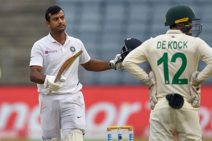India's Mayank Agarwal celebrates after scoring a century (100 runs) on the first day of second test cricket match between India and South Africa at the Maharashtra Cricket Association Stadium in Pune on October 10, 2019. (AFP)