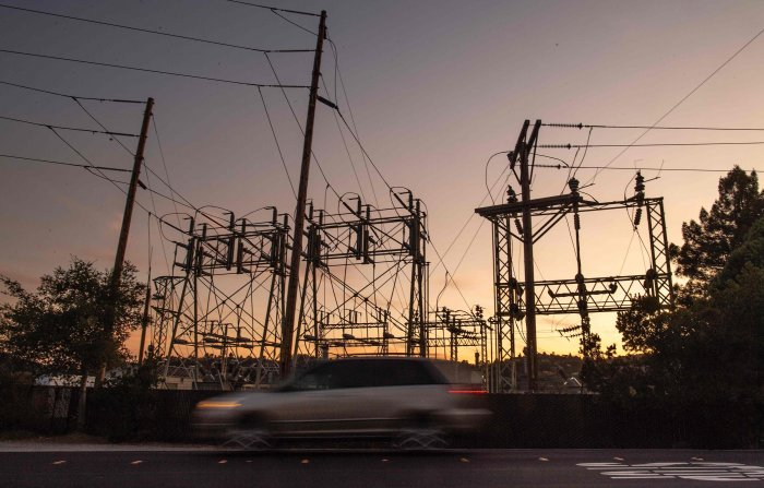 Power will be restored to areas once up to 77 mph winds die down and 2,500 miles of transmission lines could be inspected. (AFP Photo)