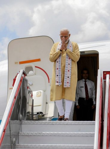 Primer Minister Narendra Modi gestures as he arrives in Chennai, ahead of a summit with his Chinese counterpart President Xi Jinping. AFP Photo