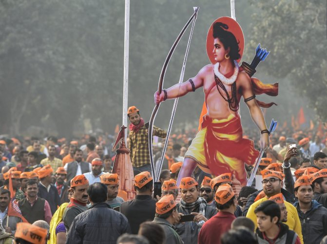 Vishwa Hindu Parishad's (VHP) supporters carry a cutout of Lord Ram during 'Dharma Sabha', in which thousands of people gathered at Ramlila Maidan to press for the construction of Ram Temple in Ayodhya. (PTI Photo)