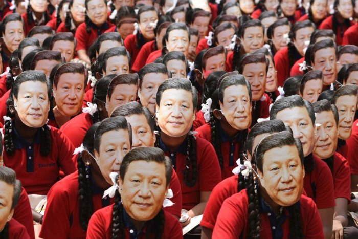Schoolchildren wear masks of China's President Xi Jinping in Chennai on Thursday. AFP