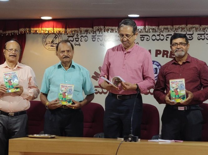 Kavitha Trust founder-president Melwin Rodrigues releases multilingual writer J F D'Souza's 13th book in Konkani language for children, 'Robin Hood and Adventure Stories of Yesteryears' at Patrika Bhavan, Mangaluru, on Thursday.