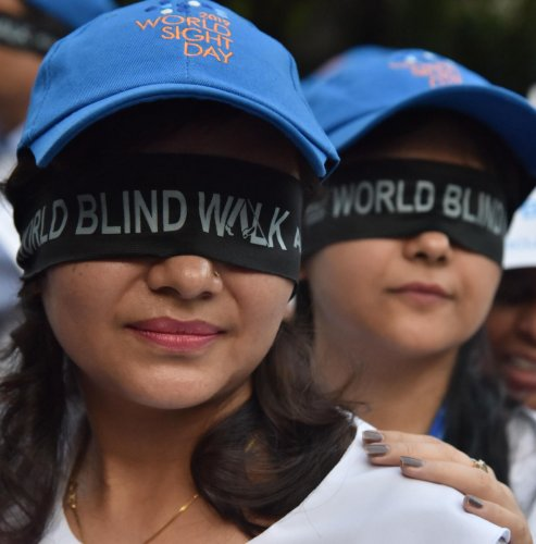 Participants at the World Blind Walk from St Joseph School to Brigade road (Samson) circle organised by Y' S Men International in Bengaluru on Thursday, 10 October, 2019. Photo by Janardhan B K