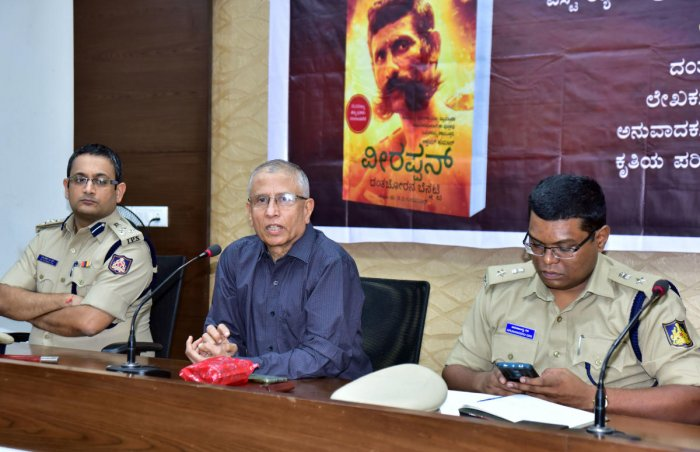 Dr D V Guruprasad, former chief of State Intelligence Department, speaks during programme at the Mangaluru City Police Commissionerate office on Thursday. Mangaluru Police Commissioner Dr P S Harsha and DC (Law and Order) Arunangshu Giri look on.