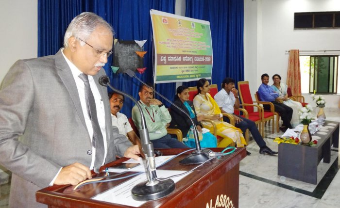 Principal District and Sessions Judge C M Joshi speaks after inaugurating World Mental Health Day programme organised at IMA Hall in Udupi on Thursday.