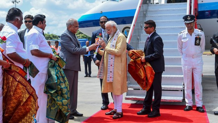 In this handout photograph taken and released by Indian Ministry of External Affairs (MEA) on October 11, 2019, India's Primer Minister Narendra Modi (C-R) arrives in Chennai, ahead of a summit with his Chinese counterpart President Xi Jinping to be held