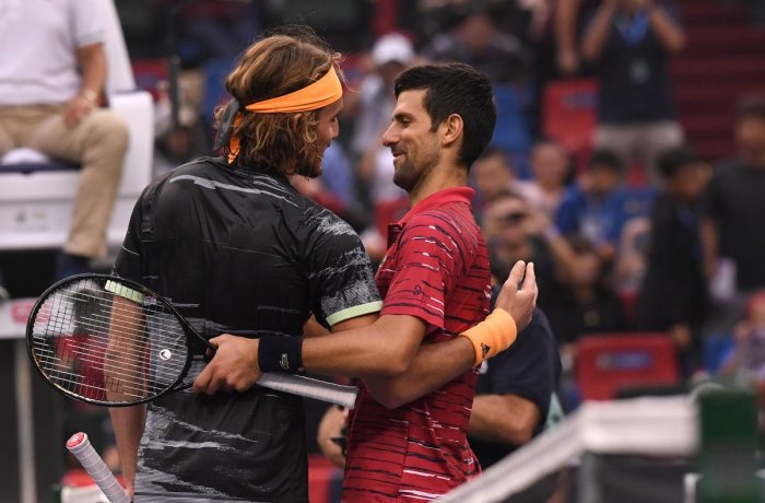 Stefanos Tsitsipas of Greece (L) speaks with Novak Djokovic of Serbia after winning their men's singles quarter-final match at the Shanghai Masters tennis tournament in Shanghai on October 11, 2019. (AFP)