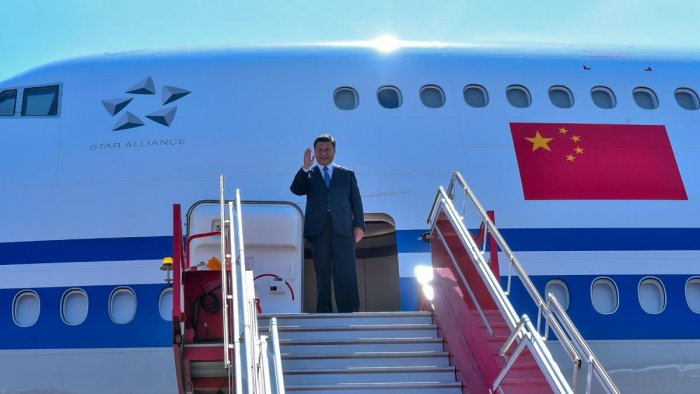 China's President Xi Jinping waves as he arrives in Chennai, to attend a summit with India's Prime Minister Narendra Modi at the World Heritage Site of Mahabalipuram from October 11 to 12. (Photo by Handout / Indian Ministry of External Affairs (MEA) / AF