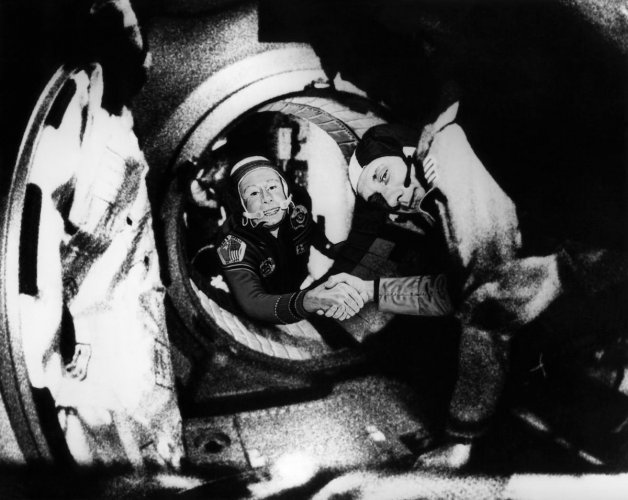 (FILES) In this file photo taken on July 17, 1975, Commander of the Soviet crew of Soyuz, Alexei Leonov (L) and commander of the US crew of Apollo, Thomas Stafford (R), shake hands after the Apollo-Soyuz docking maneuvers. AFP/HO/NASA