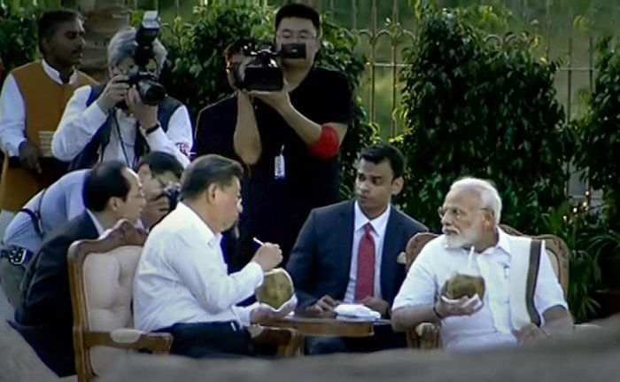 Prime Minister Narendra Modi speaks with Chinese President Xi Jinping, in Mamallapuram, Friday, Oct. 11, 2019. (PTI Photo)