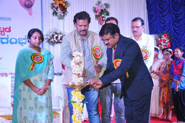 Principal Arjun Singh lights a lamp on the occasion of the inauguration of new building of Kendriya Vidyalaya in Madikeri on Friday.