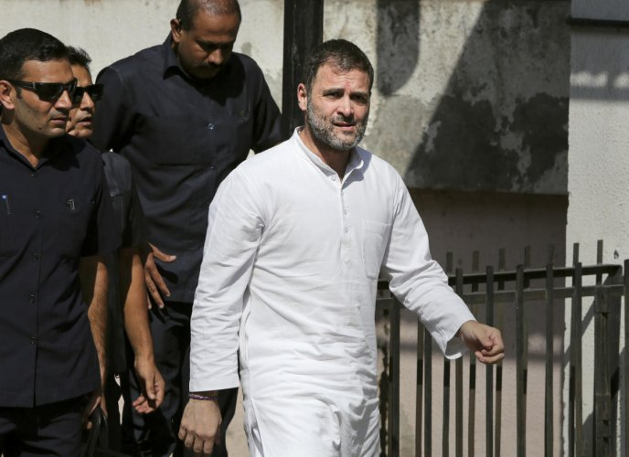 Congress leader Rahul Gandhi arrives in local courts in connection with two criminal defamation suits filed against him, in Ahmedabad, Friday, Oct. 11, 2019. Rahul Gandhi pleaded not guilty in defamation suit filed against him for calling senior BJP leader Amit Shah a murder accused. PTI