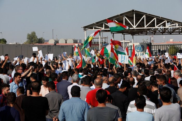 Syrian Kurds protest the Turkish offensive against Syria during a demonstration in front of the United Nation Headquarter in Erbil, Iraq. (Reuters Photo)