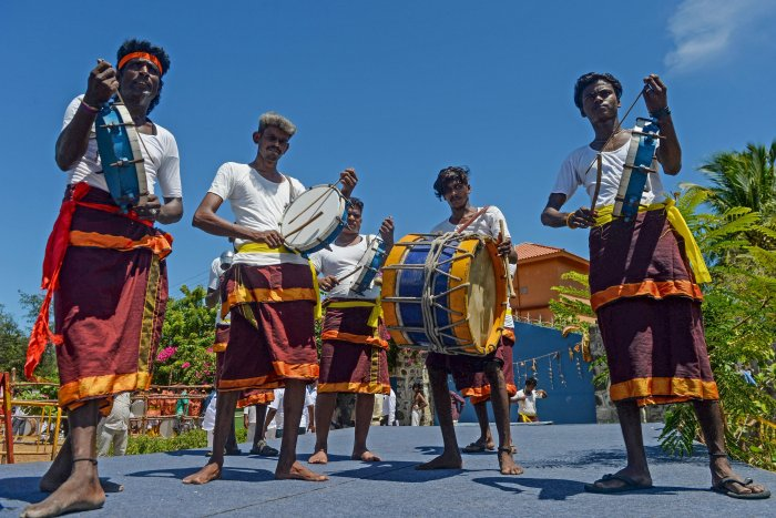Chenda Melam (Kerala's percussion instruments) artists prepare to welcome China's President Xi Jinping in Chennai on October 11, 2019, ahead of a summit with India's Prime Minister Narendra Modi (L) to be held at world heritage site of Mahabalipuram from October 11 to 12 in Tamil Nadu state. (AFP Photo)