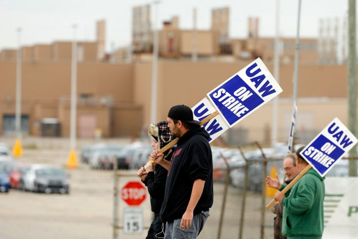 Amy and Matthew Harper walk the picket line outside General Motors (GM) Orion Assembly. (AFP Photo)