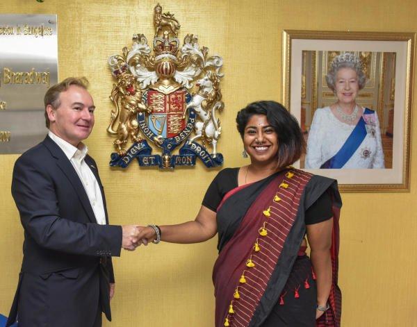 Jeremy Pilmore-Bedford, Deputy High Commissioner, British Deputy High Commission Bengaluru greets Ambalika Banerjee, at One day British Deputy High Commissioner. (DH photo/S K Dinesh)