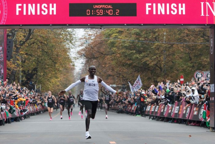 Kenya's Eliud Kipchoge on Saturday made history, busting the mythical two-hour barrier for the marathon on a specially prepared course in a huge Vienna park. AFP Photo