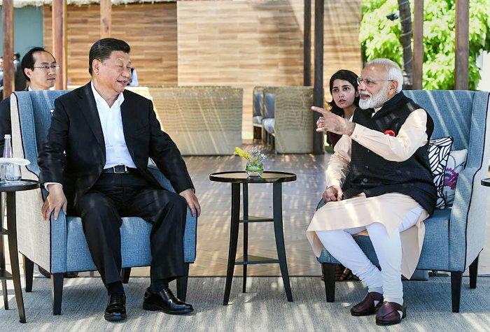 Prime Minister Narendra Modi with Chinese President Xi Jinping, at Fisherman's Cove in Kovalam near Mamallapuram. (PTI Photo)