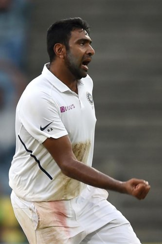 India's R Ashwin celebrates after dismissing South Africa's Keshav Maharaj on the third day of the second Test in Pune on Saturday. AFP