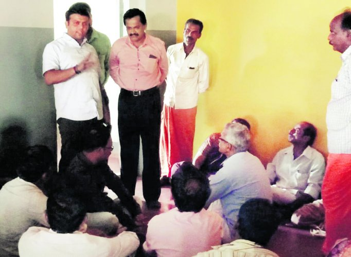 Belthangady MLA Harish Poonja addresses parents staging a dharna at the daycare centre for endosulfan victims in Kokkada in Beltangady taluk on Saturday.