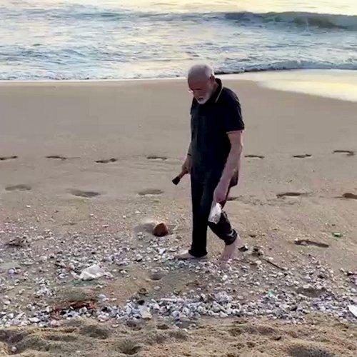 Prime Minister Narendra Modi during a morning walk along the scenic coast of Mamallapuram. (PTI Photo)