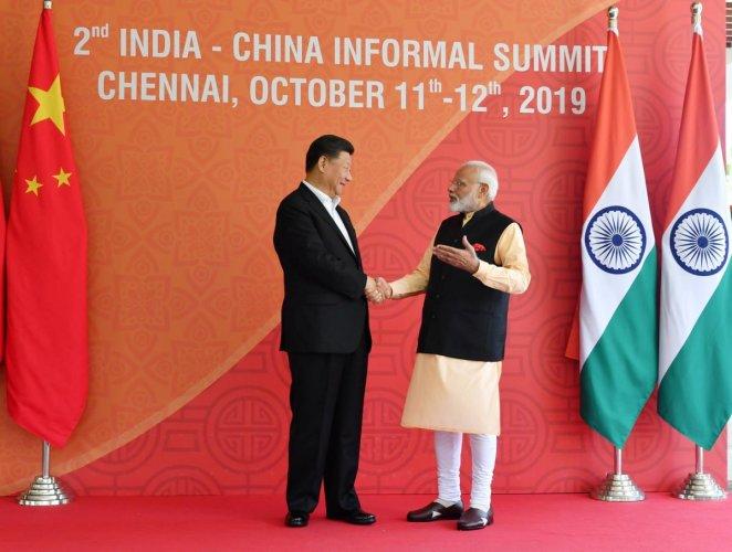 Xi Jingping and Narendra Modi during informal summit. (DH Photo)