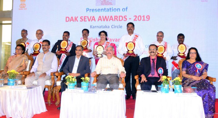 Dak Seva awardees with the dignitaries at 'Karnapex 2019' held at TMA Pai Convention Hall in Mangaluru. DH photo